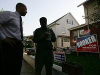 NEWARK, NJ - MAY 04: Cory Booker, a Democratic candidate for mayor of Newark, campaigns May 04, 2006 in Newark, New Jersey. Booker, who holds degrees from Yale, Oxford and Stanford, is running for mayor for the second time after narrowly loosing in 2002 to long-time Mayor Sharpe James. James …
