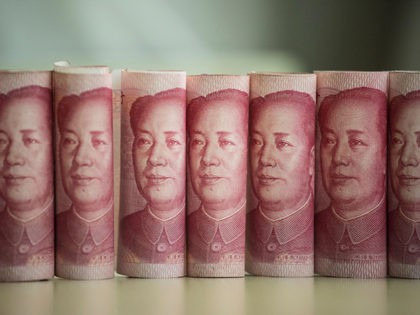 This photo illustration taken on January 6, 2017 shows Chinese 100 yuan notes in Beijing China just raised the exchange rate for the yuan against the US dollar by 0.92 percent from the previous day, the biggest one-day increase in more than 11 years. / AFP / FRED DUFOUR (Photo …