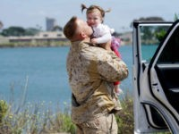 Gunnery Sgt. Michel Grabau hugs his daughter Mikaelie during a homecoming reception at Camp Pendleton in Oceanside, California on May 11, 2017.