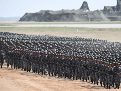 Chinese soldiers march in a military parade at the Zhurihe training base in China's northern Inner Mongolia region on July 30, 2017. China held a parade of its armed forces on July 30 to mark the 90th anniversary of the People's Liberation Army (PLA) in a display of military might. …