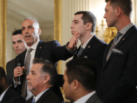 Andrew Pollack (2nd L), whose daughter Meadow Pollack was shot to death last week at Marjory Stoneman Douglas High School, is joined by his sons as he addresses a listening session with U.S. President Donald Trump in the State Dining Room at the White House February 21, 2018 in Washington, …