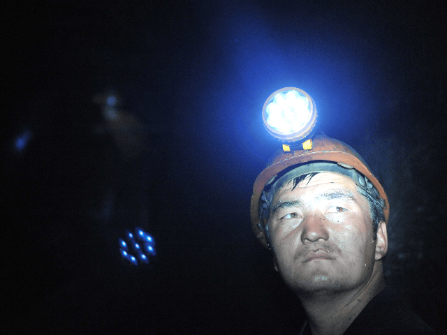A Kyrgyz man works in a mine in Markay on May 20, 2009. No place on earth is blacker than the heart of a coal mine, especially one without lamps or for that matter power tools or even oxygen masks.The walls of this Soviet-era mine, pregnant with coal, barely reflect …