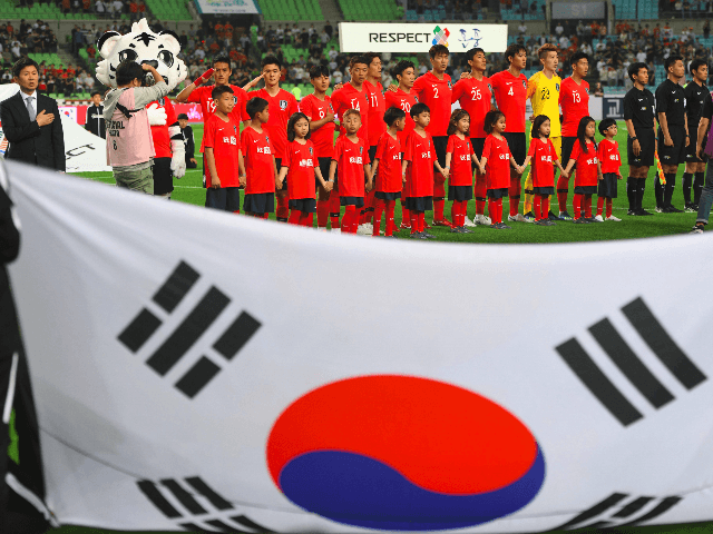South Korea team players (red) sing their national anthem prior to a friendly football match between South Korea and Honduras in Deagu on May 28, 2018. - World Cup-bound South Korea defeated Honduras 2-0 in the friendly match. (Photo by Jung Yeon-je / AFP) (Photo credit should read JUNG YEON-JE/AFP/Getty …