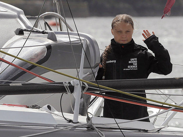 Swedish climate activist Greta Thunberg waves from aboard the Malizia II IMOCA class sailing yacht, off the coast of Plymouth, southwest England, on August 14, 2019, as she prepares to start her journey across the Atlantic to New York where she will attend the UN Climate Action Summit next month. …