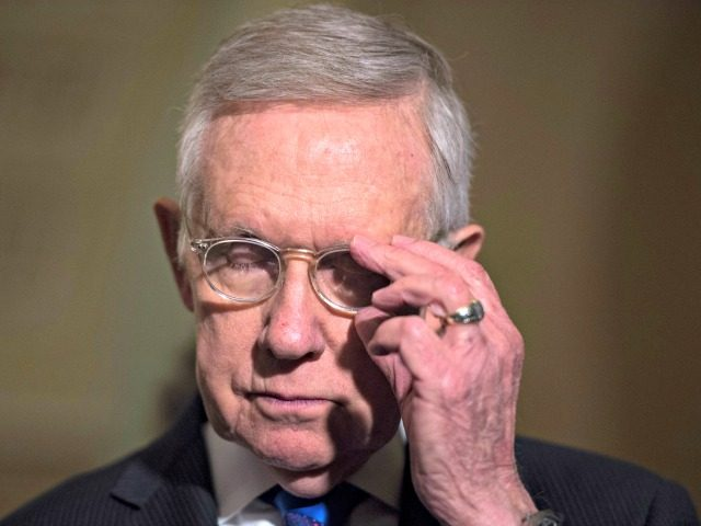 Senate Minority Leader Harry Reid, D-Nev., listens during a media availability after the Senate Policy Luncheon on Capitol Hill, Tuesday, Nov. 29, 2016 in Washington. (AP Photo/Molly Riley)