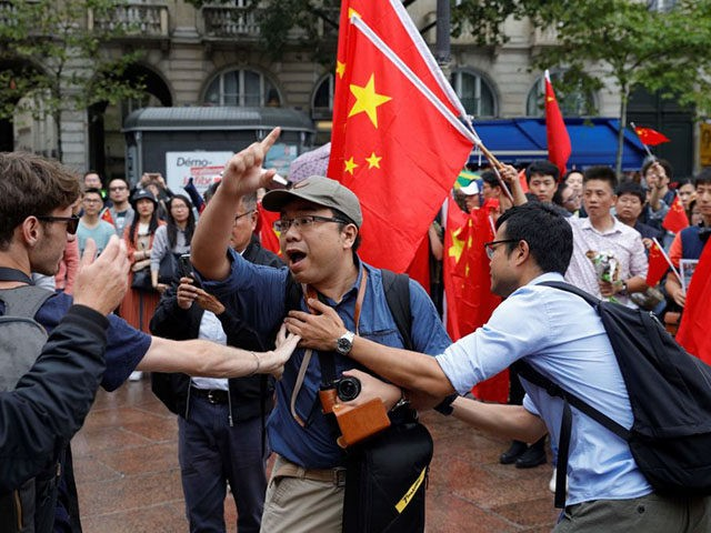 Protestors gathering to support Pro-democracy demonstrations in Hong Kong face Counter-protesters waving Chinese flags in the Place Saint Michel, central Paris, on August 17, 2019. - Ten weeks of protests in Hong-Kong have plunged the city into crisis and prompted mainland China to take a more hardline tone. (Photo by …