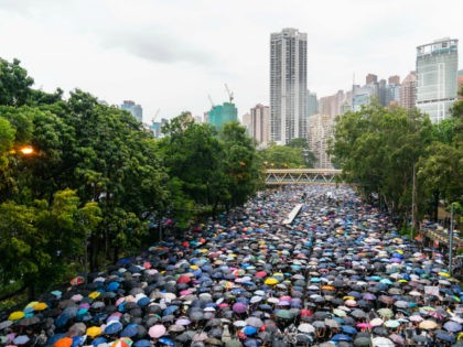 Protesters march against a controversial extradition bill in the Causeway Bay area on August 18, 2019 in Hong Kong, China. Pro-democracy protesters have continued rallies on the streets of Hong Kong against a controversial extradition bill since 9 June as the city plunged into crisis after waves of demonstrations and …