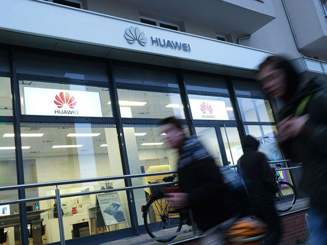 BERLIN, GERMANY - MARCH 12: People walk past a Huawei customer service center on March 12, 2019 in Berlin, Germany.