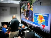 Emergency Center personnel stand next to a tv screen showing a meteorological image of the tropical storm Dorian, as they await its arrival, in Ceiba, Puerto Rico, Wednesday, Aug. 28, 2019. Puerto Rico is facing its first major test of emergency preparedness since the 2017 devastation of Hurricane Maria as …