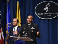 Surgeon General Jerome Adams (R) speaks watched by Health and Human Services Secretary Alex Azar as they brief the media on the release of an advisory on marijuana, August 29, 2019, in Washington, DC. - The Surgeon General issued the advisory emphasizing the importance of protecting youth and pregnant women …
