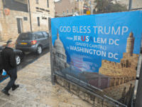 JERUSALEM, ISRAEL - DECEMBER 06: (ISRAEL OUT) An Ultra Orthodox Jewish man walks next to a poster blessing U.S President Donald Trump in downtown on December 6, 2017 in Jerusalem, Israel. U.S. President Donald Trump will announce his recognition of Jerusalem as Israel's capital on Wednesday. (Photo by Lior Mizrahi/Getty …