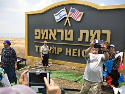 GOLAN HEIGHTS, ISRAEL - JUNE 17: Israeli people take photos of a sign for a new settlement named after US President Donald Trump on June 17, 2019 in Golan Heights, Israel. The Israeli goverment named the new settlement 'Trump Heights' to honor Trump's decision to recognise sovereignty over the Golan …