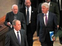 Former President George Bush is followed by former Presidents Jimmy Carter and Bill Clinton, right. as they arrive for a funeral service for former and former Georgia Gov. Zell Miller Tuesday, March 27, 2018, in Atlanta.(AP Photo/John Bazemore)