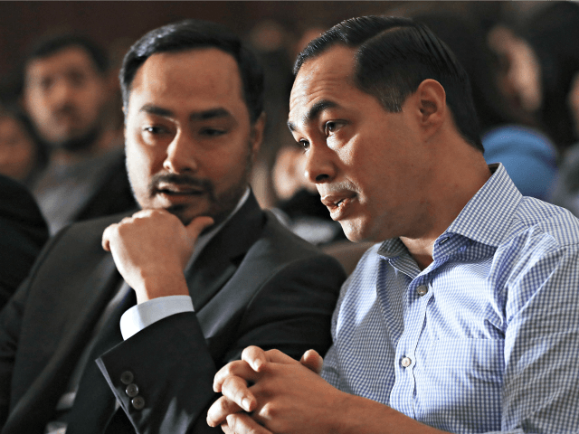 BELL GARDENS, CALIFORNIA - MARCH 04: Democratic presidential candidate Julian Castro (R) and his twin brother U.S. Rep. Joaquin Castro (D-TX) sit at a campaign appearance at Bell Gardens High School, in Los Angeles county, on March 4, 2019 in Bell Gardens, California. Castro, who served as Secretary of Housing …