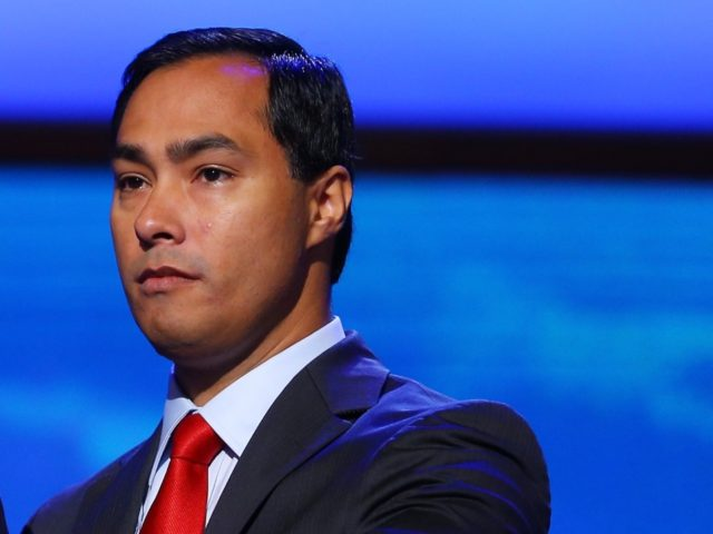 CHARLOTTE, NC - SEPTEMBER 02: San Antonio Mayor Julian Castro (L) stands on stage at the podium with his brother Joaquin Castro, Texas House of Representative Democrat, during preparations for the Democratic National Convention at Time Warner Cable Arena on September 2, 2012 in Charlotte, North Carolina. The DNC that …