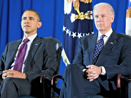 JOINT BASE ANDREWS, MD - DECEMBER 20: U.S. President Barack Obama (L) and U,S. Vice President Joe Biden participate in a ceremony to mark the return of the United States Forces-Iraq Colors and the end of the Iraq war on December 20, 2011 at Joint Base Andrews, Maryland. The last …