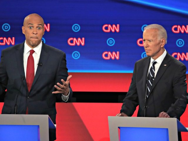 DETROIT, MICHIGAN - JULY 31: Democratic presidential candidate Sen. Cory Booker (D-NJ) (L) speaks while former Vice President Joe Biden listens during the Democratic Presidential Debate at the Fox Theatre July 31, 2019 in Detroit, Michigan. 20 Democratic presidential candidates were split into two groups of 10 to take part …