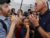 Joel Pollak and Joe Biden (Chip Somodevilla / Getty)