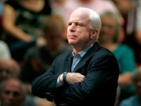In this Aug. 25, 2009 file photo, Sen. John McCain, R-Ariz., holds a healthcare town hall meeting in Sun City, Ariz. McCain's family says the Arizona senator has chosen to discontinue medical treatment for brain cancer. (AP Photo/Matt York)