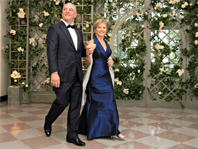 WASHINGTON, DC - APRIL 24: Louisiana Gov. John Bel Edwards and his wife Donna arrive at the White House for a state dinner April 24, 2018 in Washington, DC . President Donald Trump is hosting French President Emmanuel Macron for the first state visit of his presidency. (Photo by Aaron …