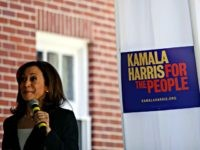 US Senator and Democratic presidential candidate Kamala Harris speaks to a porch full of supporters at a meet and greet at an historic home in Columbia, South Carolina on June 21, 2019. - Many of the Democratic candidates running for president are in Columbia to make appearances at the South …