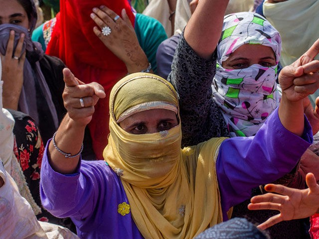 SRINAGAR, KASHMIR, INDIA - AUGUST 23: Kashmiri Muslims women shout anti Indian slogans during an anti Indian protest, on August 23, 2019 in Srinagar, the summer capital of Indian administered Kashmir, India. Indian authorities have deployed its thousands of government forces in Kashmir for the last three weeks after India …