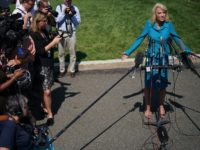 """WASHINGTON, DC - JULY 16: White House Counselor to the President Kellyanne Conway talks to reporters outside of the West Wing July 16, 2019 in Washington, DC. Conway defended U.S. President Donald Trump's weekend remarks on Twitter, writing that four Democratic congresswomen of color to """"go back"""" to their own …"""