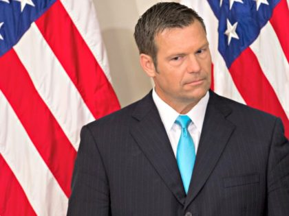 Kansas Secretary of State Kris Kobach listens as US President Donald Trump speaks during the first meeting of the Presidential Advisory Commission on Election Integrity in the Eisenhower Executive Office Building next to the White House in Washington, DC, July 19, 2017. / AFP PHOTO / SAUL LOEB (Photo credit …