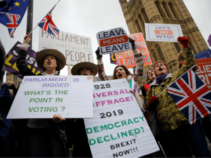 "Pro-Brexit activists hold placards and wave Union flags as they demonstrate outside of the Houses of Parliament in London on January 29, 2019. - British Prime Minister Theresa May will seek ""legal changes"" to the Brexit deal she agreed with EU leaders only last month to try to secure the …"