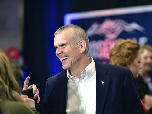Republican Senate candidate Matt Rosendale talks with supporters Tuesday, Nov. 6, 2018 at the Delta Hotel in Helena, Mont., as he and his supporters wait for the poll results. (AP Photo/ Eliza Wiley)