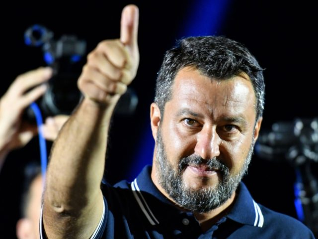 "Far-right Interior Minister Matteo Salvini gestures during his electoral tour on August 9, 2019 in Mola di Bari, south of Italy. - Salvini pulled his support for Italy's governing coalition on August 8, 2019, and called for snap elections, prompting the country's premier to demand that he ""justify"" his decision …"