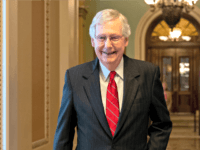 Senate Majority Leader Mitch McConnell, R-Ky., smiles after vote on a hard-won budget deal that would permit the government to resume borrowing to pay all of its obligations and would remove the prospect of a government shutdown in October, at the Capitol in Washington, Thursday, Aug. 1, 2019. (AP Photo/J. …