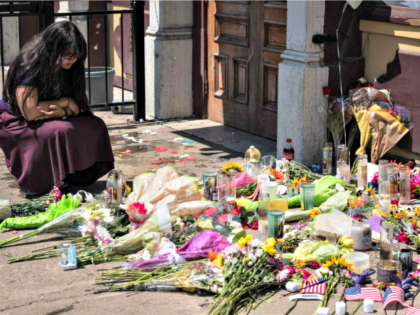 A woman kneels Monday at a memorial in Dayton, Ohio, where a mass shooting took place this weekend only hours after the shooting in El Paso.Megan Jelinger/AFP/Getty Images