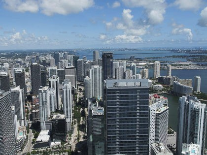 The Miami skyline is seen in this aerial view with cranes, Thursday, Sept. 7, 2017, in Miami. As Hurricane Irma threatens to pound Miami with winds of mind-boggling power, a heavyweight hazard looms over the city's skyline: two dozen enormous construction cranes.(DroneBase via AP)