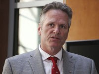 Alaska Gov. Mike Dunleavy speaks at a news conference Monday, Aug. 5, 2019, in Anchorage, Alaska. State health department officials discussed proposals they are seeking for a study on the feasibility of privatizing Alaska's state-owned psychiatric hospital and announced the Alaska Psychiatric Institute is in good standing with federal requirements. …