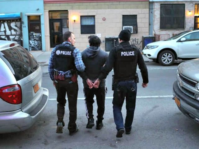 "U.S. Immigration and Customs Enforcement (ICE), officers arrest an undocumented Mexican immigrant during a raid in the Bushwick neighborhood of Brooklyn on April 11, 2018 in New York City as part of ""Operation Keep Safe."" JOHN MOORE/GETTY"