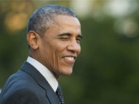 US President Barack Obama winks at the press as he prepares to depart the White House in Washington, DC, October 1, 2014. Obama is heading to Chicago where he will attend a campaign event for Gov. Pat Quinn, D-Il, and deliver remarks on the economy at Northwestern University. AFP PHOTO …