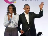 In this Oct. 31, 2017, file photo, former President Barack Obama, right, and former first lady Michelle Obama appear at the Obama Foundation Summit in Chicago. The Obamas have unveiled a slate of projects in development for Netflix, a year after the former president and first lady signed a deal …