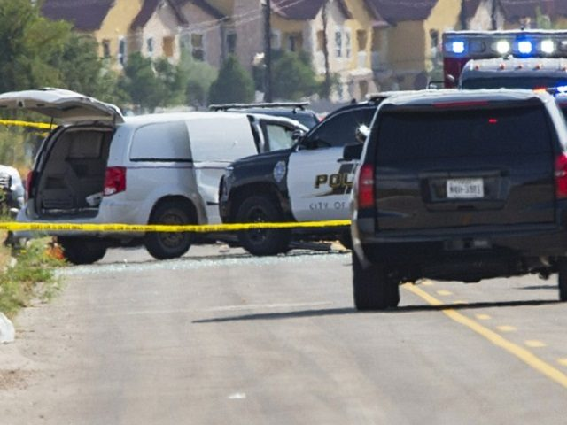 "Odessa and Midland police and sheriff's deputies surround a white van in Odessa, Texas, Saturday, Aug. 31, 2019, after reports of gunfire. Police said there are ""multiple gunshot victims"" in West Texas after reports of gunfire on Saturday in the area of Midland and Odessa. (Tim Fischer/Midland Reporter-Telegram via AP)"