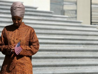 WASHINGTON, DC - JULY 25: Rep. Ilhan Omar (D-MN) joins fellow House Democrats to mark the 200th day of the 116th Congress on the steps outside the U.S. Capitol July 25, 2019 in Washington, DC. Just hours before leaving for the six-week summer recess, Congress is set to pass a …