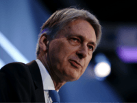 Britain's Chancellor of the Exchequer Philip Hammond speaks during the The International FinTech Conference 2018, in central London on March 22, 2018. / AFP PHOTO / POOL / Daniel LEAL-OLIVAS (Photo credit should read DANIEL LEAL-OLIVAS/AFP/Getty Images)