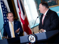 US Secretary of State Mike Pompeo (R) listens while British Foreign Secretary Dominic Raab speaks to reporters during a press conference at the US Department of State on August 7, 2019, in Washington, DC. (Photo by Brendan Smialowski / AFP) (Photo credit should read BRENDAN SMIALOWSKI/AFP/Getty Images)