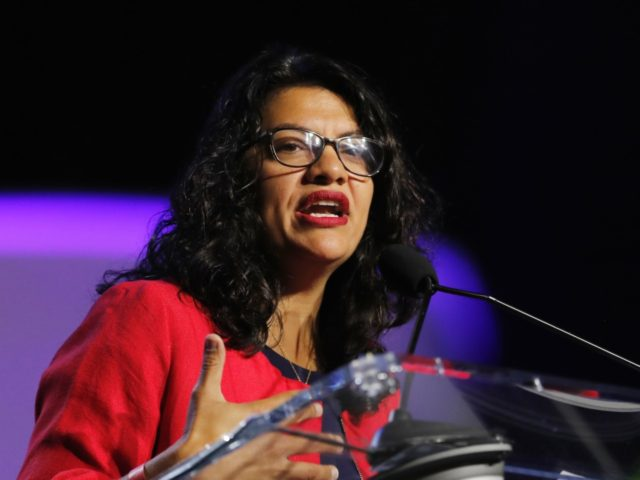 Rep. Rashida Tlaib, D-Mich., addresses the 110th NAACP National Convention, Monday, July 22, 2019, in Detroit. (AP Photo/Carlos Osorio)