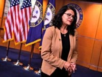 US Representative Rashida Tlaib (D-MI) looks on during an interview after a press conference, to address remarks made by US President Donald Trump earlier in the day, at the US Capitol in Washington, DC on July 15, 2019. - President Donald Trump stepped up his attacks on four progressive Democratic …