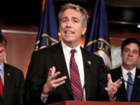 In this Nov. 15, 2011, file photo former Rep. Joe Walsh, R-Ill., gestures during a news conference on Capitol Hill in Washington. The former Illinois congressman and radio host is standing by a Twitter post he sent after the fatal shooting of five police officers in Dallas in which he …