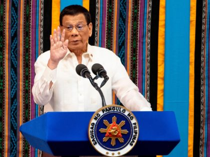 Philippine President Rodrigo Duterte gestures as he delivers his state of the nation address at Congress in Manila on July 22, 2019. (Photo by Noel CELIS / AFP) (Photo credit should read NOEL CELIS/AFP/Getty Images)