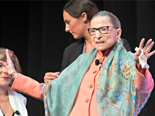 Supreme Court Associate Justice Ruth Bader Ginsburg waves to the audience as she prepares to speak at the Library of Congress National Book Festival in Washington, Saturday, Aug. 31, 2019. (AP Photo/Cliff Owen)