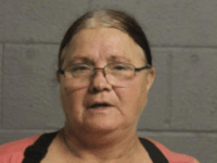 Sherry Kirk, 62, of War, has been charged with attempt to kill or injure a person by poison.