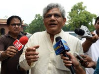 Communist Party of India (CPI) Leader Sitaram Yechury interacts with media representatives as he arrives at Parliament House in New Delhi on August 12, 2015. The NDA government led by Prime Minister Narendra Modi is attempting to guide the General Service Tax (GST) through parliament paving the way for a …