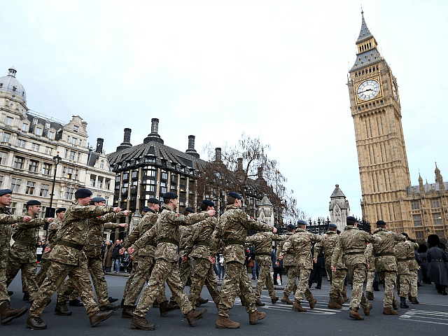 LONDON, ENGLAND - JANUARY 26: Military personnel march into the Houses of Parliament on January 26, 2015 in London, England. 120 military personnel from all three services were accompanied by the Band of the Grenadier Guards as they marched from Wellington Barracks to the Houses of Parliament. The march was …